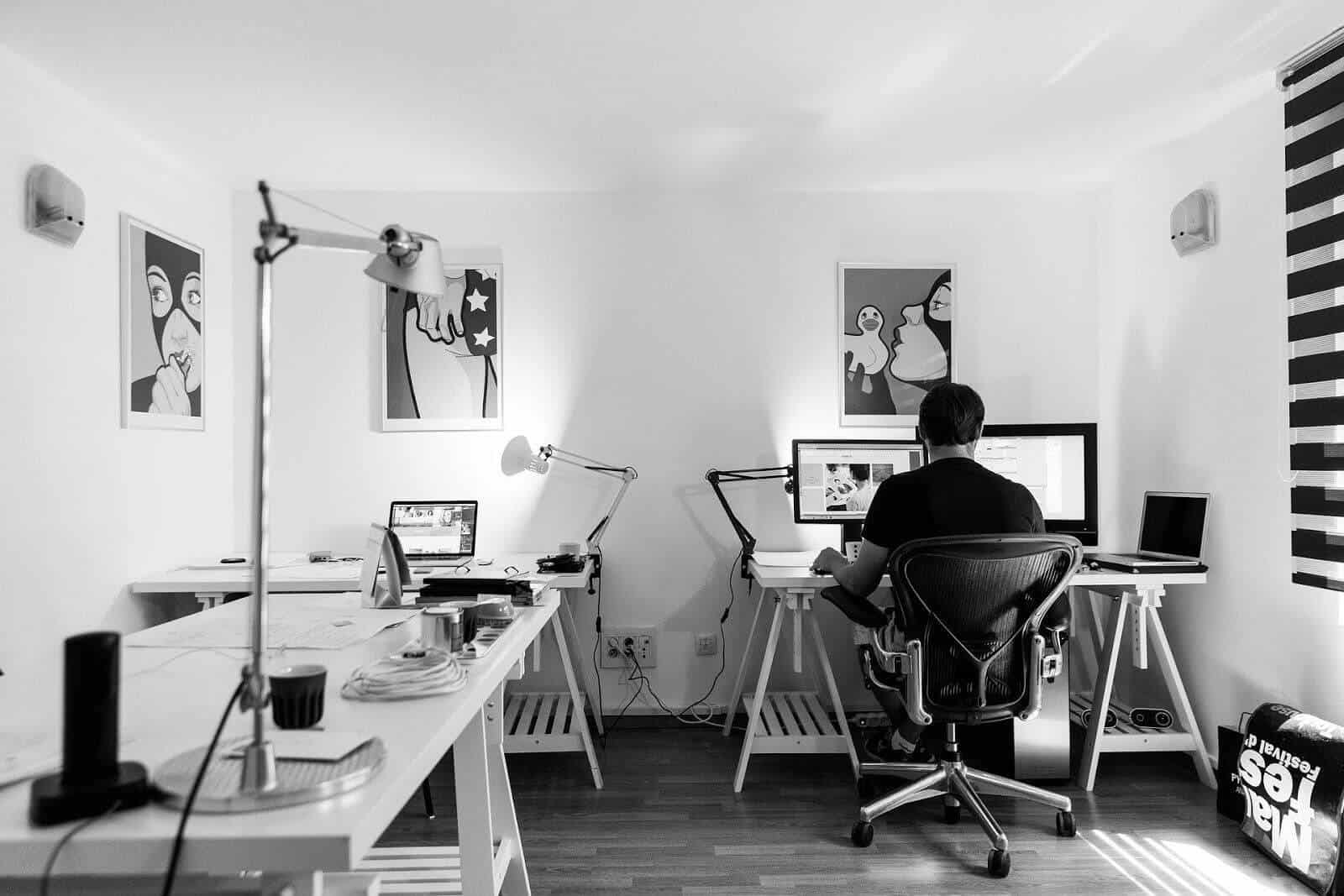 Home office in Black & White with 3 tables made with painting trestles