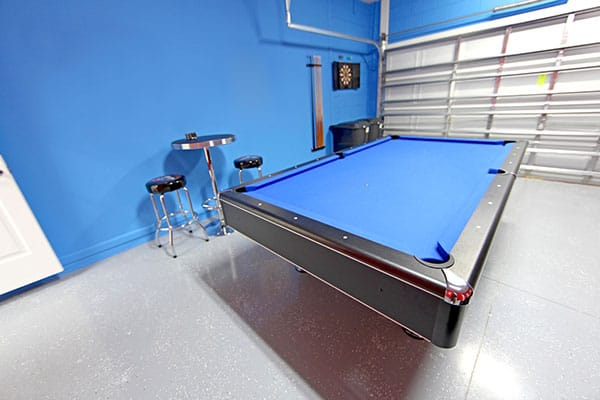 garage man cave with a pool table