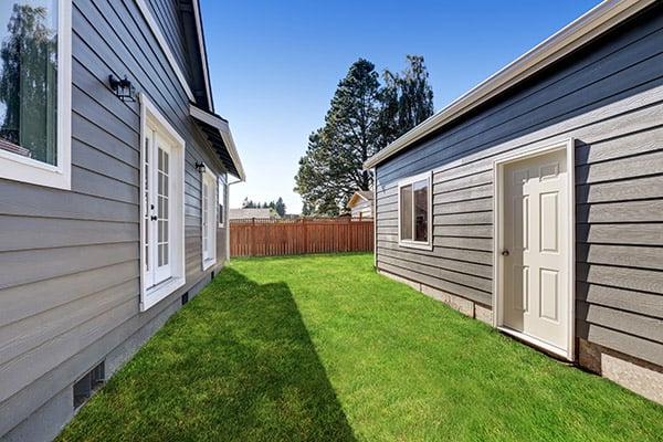 matching vinyl siding on detached garage and house