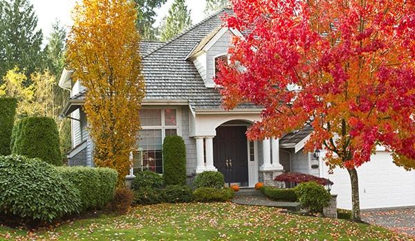 fall season suburban home and garage
