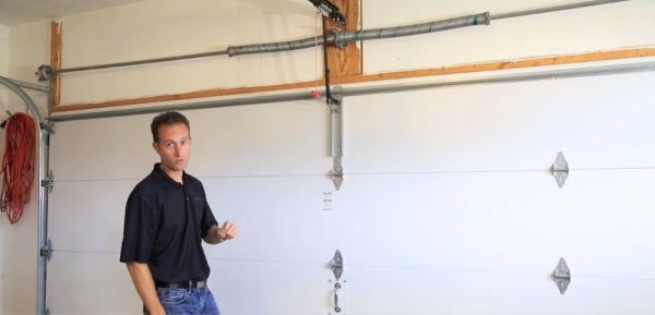man explaining garage door maintenance