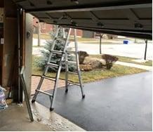 broken rollers on a garage door
