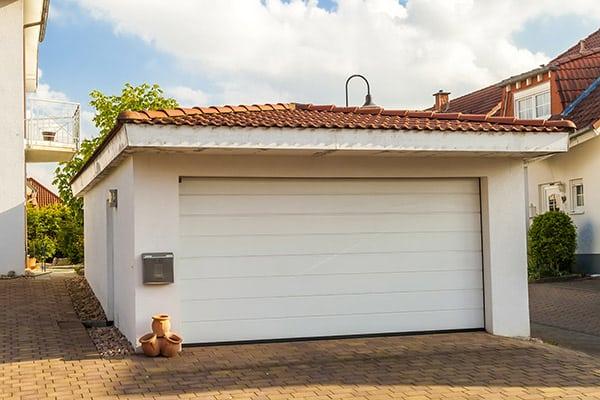 detached garage with a white garage door