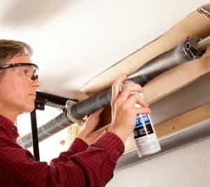 Man doing garage door maintenance