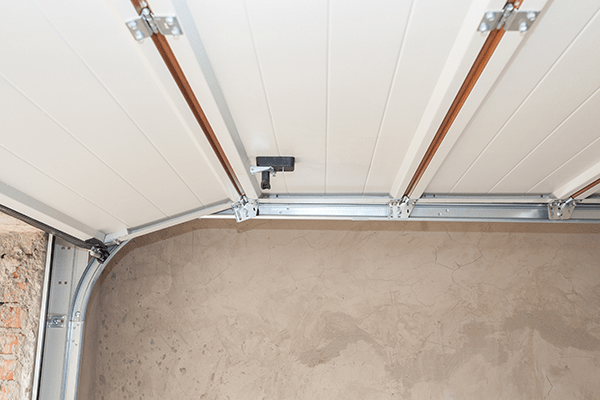 post rail and spring installation of a garage