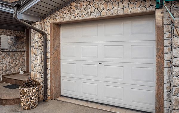 modern garage with brick siding
