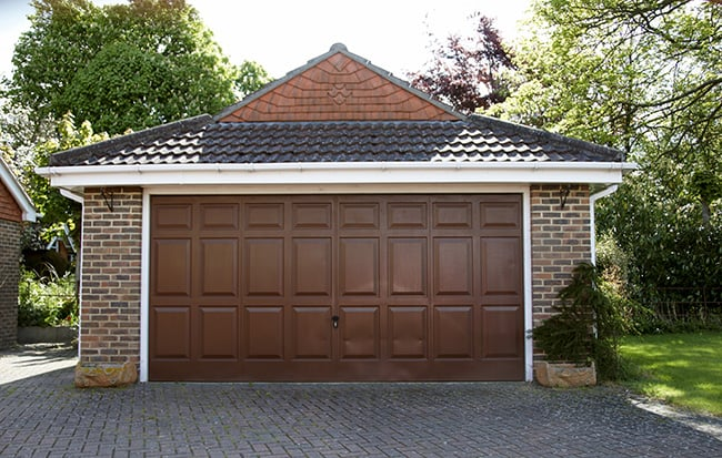 detached garage made out of brick siding