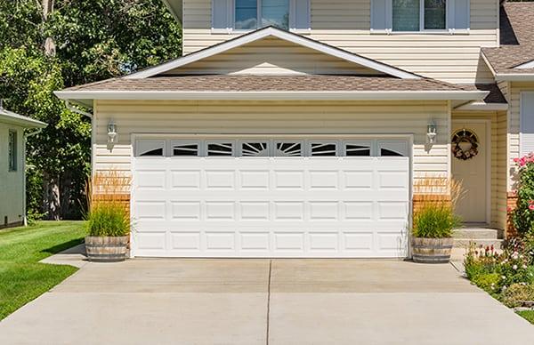 beautiful garage with white door