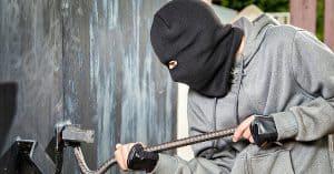 Thief breaking a lock
