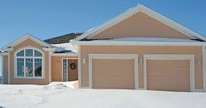 House with garage doors in winter