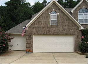performing a visual inspection of your garage door