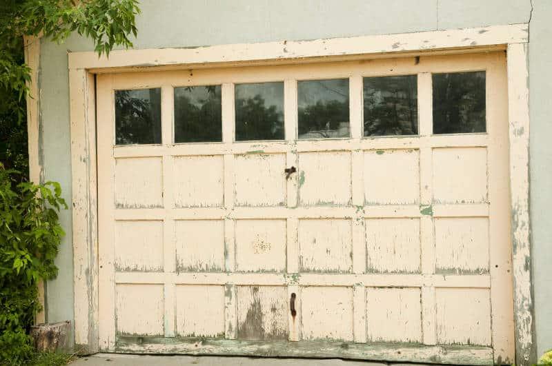 warped and rotted wood garage door