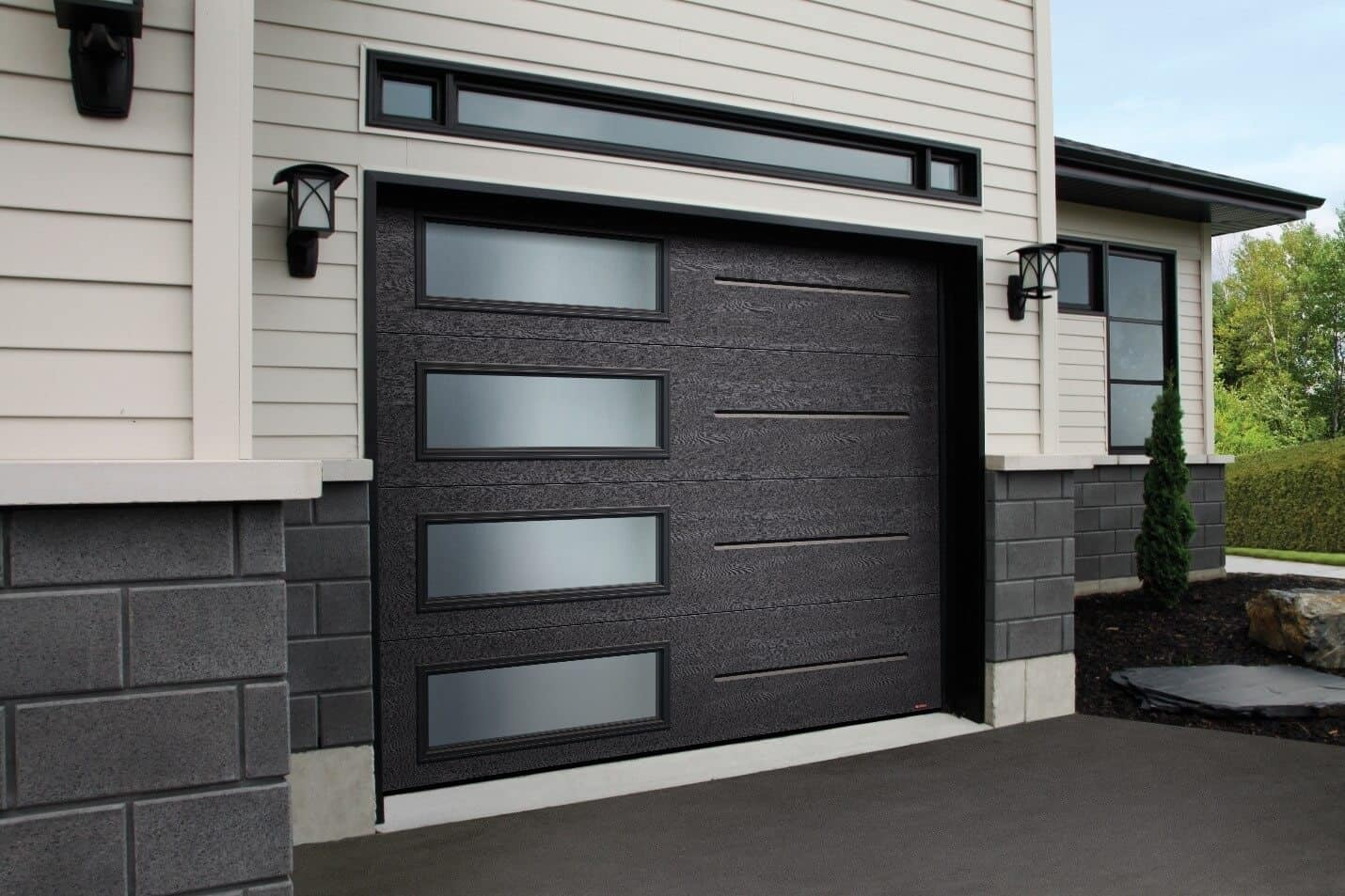 You like this look? This garage door is a Standard+ Vog, 9' x 7', Black, window layout: Left-side Harmony.