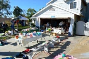 Driveway with a garage sale going on